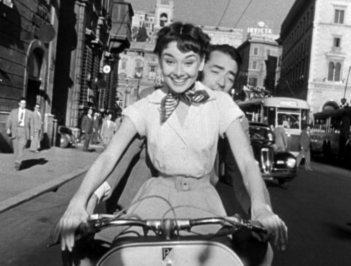 audrey_hepburn_and_gregory_peck_on_vespa_in_roman_holiday_trailer-1